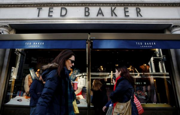 Shoppers walk past a Ted Baker store on Regents Street in London.