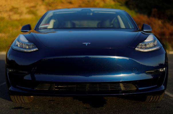 A 2018 Tesla Model 3 electric vehicle is shown in this photo illustration taken in Cardiff.