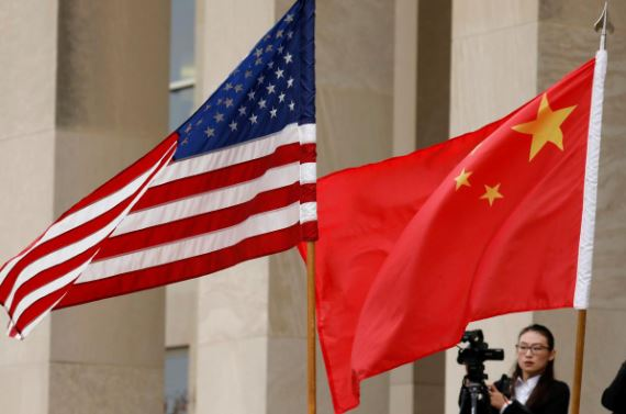 US and Chinese flags are seen before Defense Secretary James Mattis welcomes Chinese Minister of National Defense Gen. Wei Fenghe to the Pentagon in Arlington.