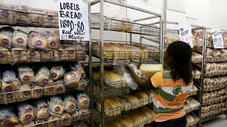 A Person is shown buying bread.