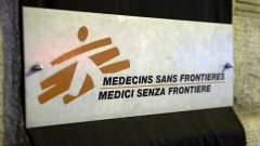 A sign is pictured over a black sheet outside the Medecins Sans Frontieres (MSF) headquarters.
