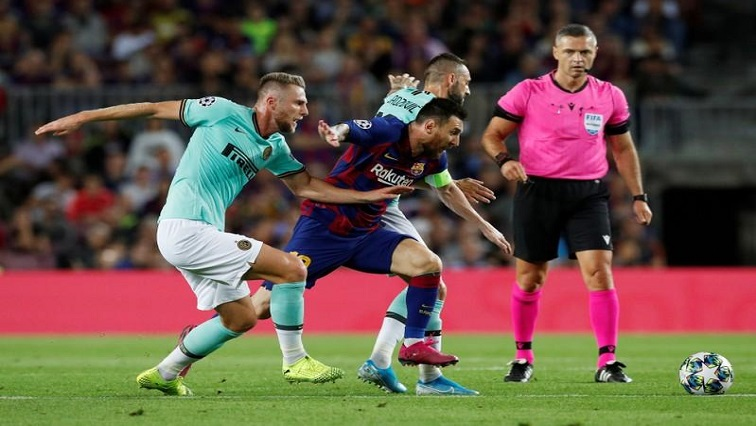 Barcelona's Lionel Messi in action with Inter Milan's Milan Skriniar and Marcelo Brozovic