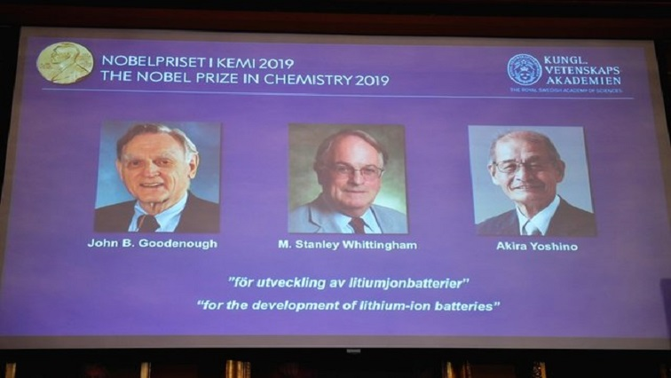 A screen displays the portraits of the laureates of the 2019 Nobel Prize in Chemistry.