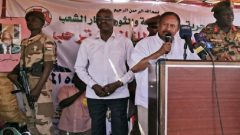 Sudan's Prime Minister in the transitional government Abdalla Hamdok addresses residents during his visit to the camps of El-Fashir in North Darfur, Sudan.