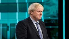 Conservative leader Boris Johnson listens during a televised debate with Labour leader Jeremy Corbyn ahead of general election in London.