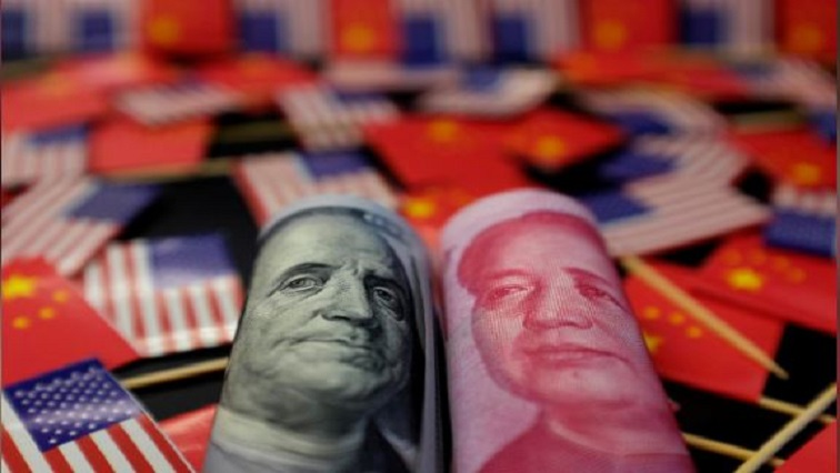 A US dollar banknote featuring American founding father Benjamin Franklin and a China's yuan banknote featuring late Chinese chairman Mao Zedong.