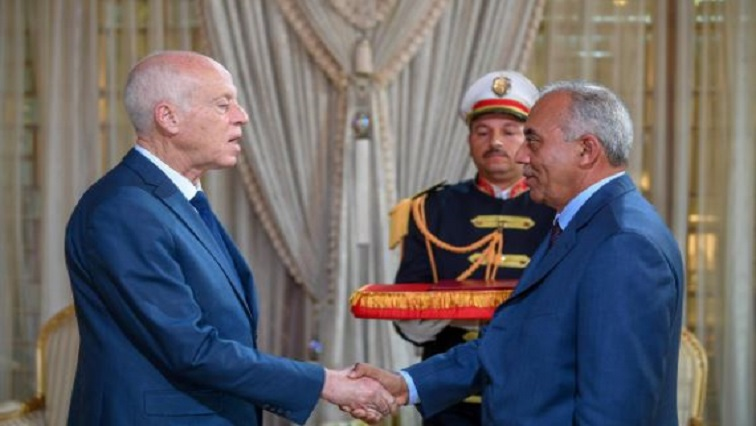 Tunisian President Kais Saied shakes hands with Prime Minister designate Habib Jemli in Tunis, Tunisia, in this handout pictured obtained.
