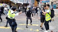 A still image from a social media video shows a police officer aiming his gun at a protester in Sai Wan Ho, Hong Kong.
