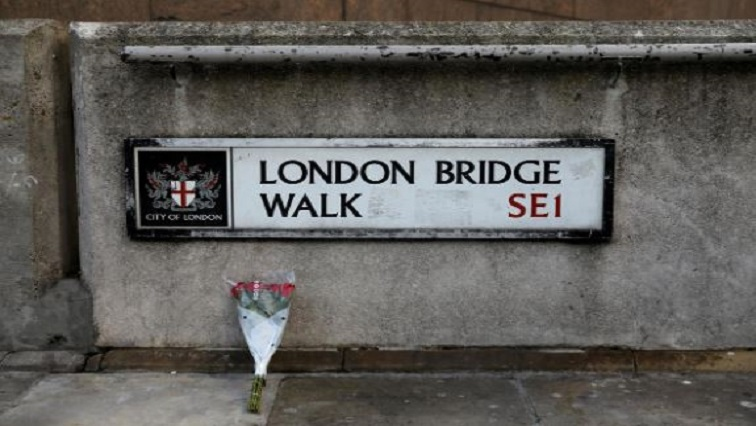 Flowers are laid down for the victims at the scene of a stabbing on London Bridge, in which two people were killed, in London, Britain, November 30, 2019.
