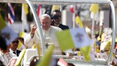 Pope Francis waves to the crowd following his visit to St. Peter's Parish church in the Sam Phran district of Nakhon Pathom Province, Thailand.
