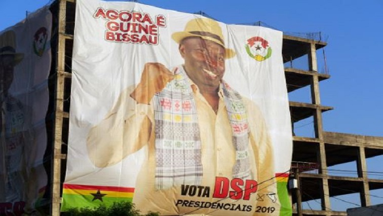 A poster of presidential candidate Domingos Simoes Pereira covers side of building under construction in Bissau, Guinea-Bissau.