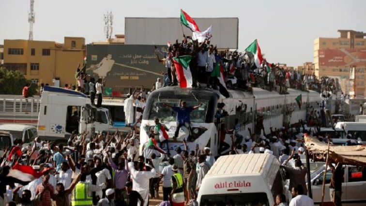 A train carrying protesters from Atbara, the birthplace of an uprising that toppled Sudan's former President Omar al-Bashir, approaches a Khartoum train station.