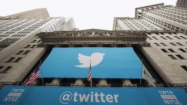 A sign displays the Twitter logo on the front of the New York Stock Exchange ahead of the company's IPO in New York.