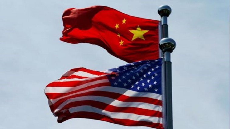 Chinese and U.S. flags flutter near The Bund, before U.S. trade delegation meet their Chinese counterparts for talks in Shanghai, China.