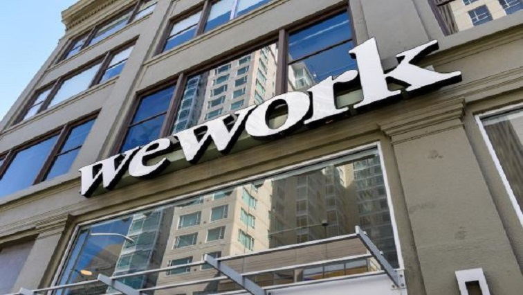 A WeWork logo is seen outside its offices in San Francisco, California.