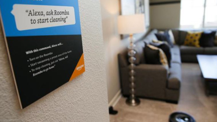 Prompts on how to use Amazon's Alexa personal assistant are seen as a wifi-equipped Roomba begins cleaning a room in an Amazon 'experience center' in Vallejo, California.