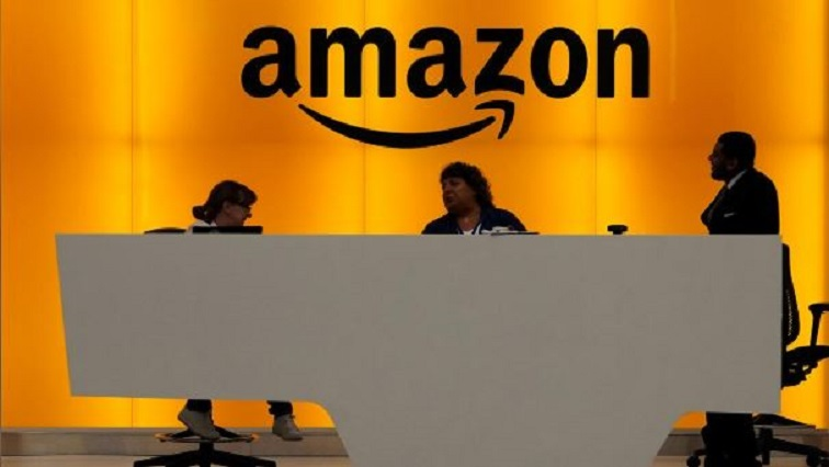 Staff chat at the front desk of the Amazon office in the Manhattan borough of New York, New York.
