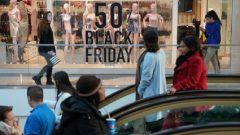 People walk through the King of Prussia mall, one of the largest retail malls in the U.S., on Black Friday, a day that kicks off the holiday shopping season.