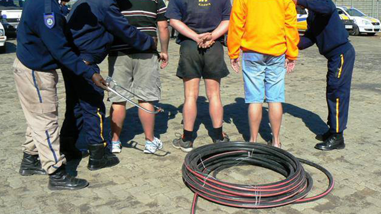 Metro employees nabbed for cable theft.