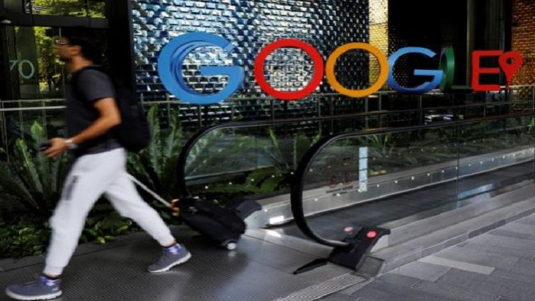 A man passes a Google signage outside their office in Singapore.