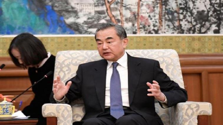 File photo of China's top diplomat Wang Yi speaking during a meeting with former Ethiopian President Mulatu Teshome in Beijing.