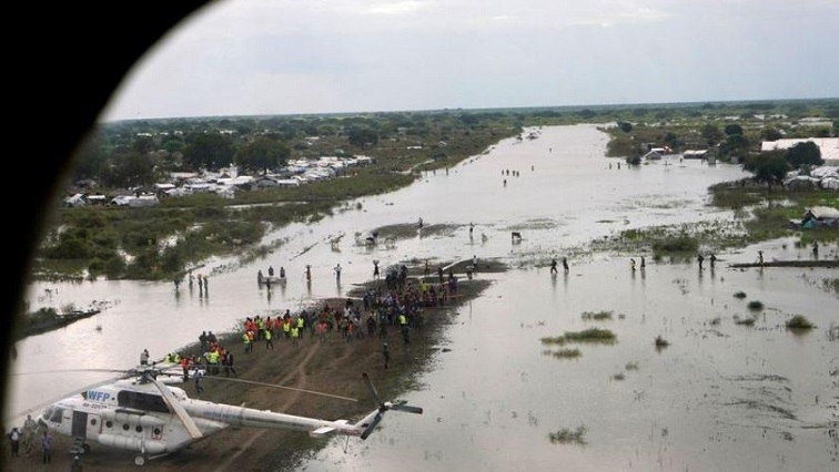 A WFP (World Food Program) helicopter is seen on the flooded airstrip, after heavy rains and floods
