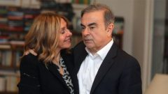 Former Nissan chairman Carlos Ghosn and his wife Carole Ghosn pose for a picture after an exclusive interview with Reuters.
