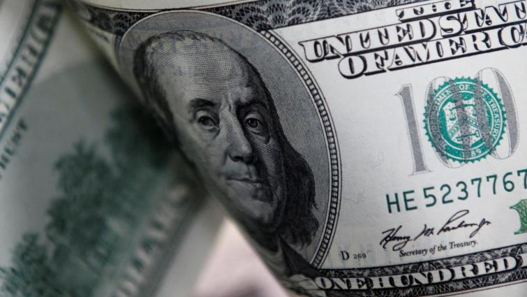 SABC News Dollar Reuters - Dollar set for best weekly gain in two months on `galvanising' forces