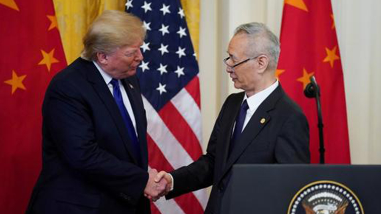 U.S. President Donald Trump shakes hands with Chinese Vice Premier Liu He during a signing ceremony.