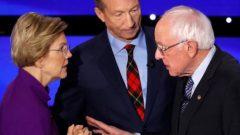 Democratic 2020 U.S. presidential candidates (L-R) Senator Elizabeth Warren (D-MA) speaks with Senator Bernie Sanders (I-VT) as billionaire activist Tom Steyer listens after the seventh Democratic 2020 presidential debate at Drake University in Des Moines.