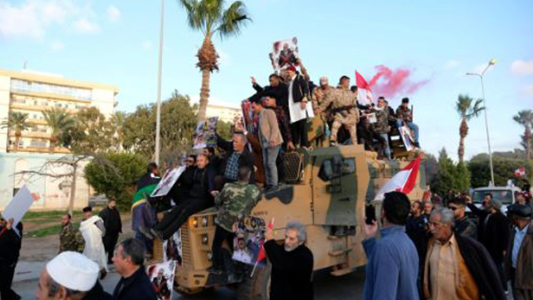 Supporters of Libyan National Army (LNA) commanded by Khalifa Haftar, celebrate on top of a Turkish military armored vehicle, which LNA said they confiscated during Tripoli clashes, in Benghazi.