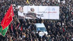 Iranian people attend a funeral procession for Iranian Major-General Qassem Soleimani, head of the elite Quds Force, and Iraqi militia commander Abu Mahdi al-Muhandis, who were killed in an air strike at Baghdad airport.