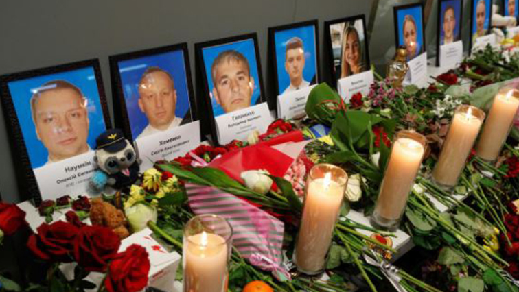Flowers and candles are placed in front of the portraits of the flight crew members of the Ukraine International Airlines Boeing 737-800 plane that crashed in Iran, at a memorial at the Boryspil International airport outside Kiev.