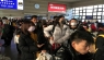 New China virus claims sixth victim as holiday travel stokes risk