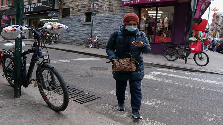 A resident of Chinatown wears a surgical mask in New York City, U.S