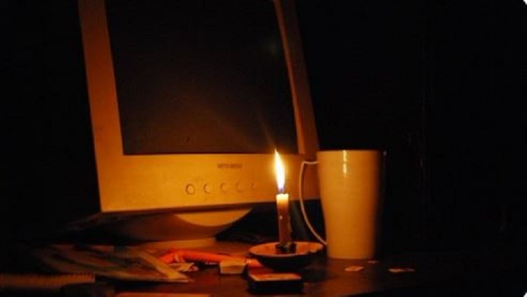 Computer and candle light
