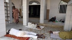 People sleeping outside Mosque
