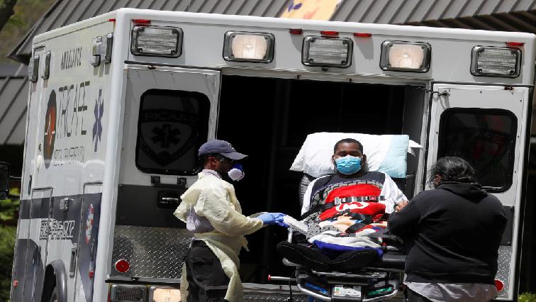 SABC News EMT unload a patient R - US insurers use lofty estimates to beat back coronavirus claims