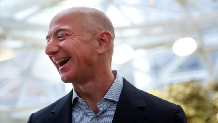 SABC NEWS Jeff Bezos R - Amazon's Bezos tops Forbes richest list, pandemic knocks Trump lower