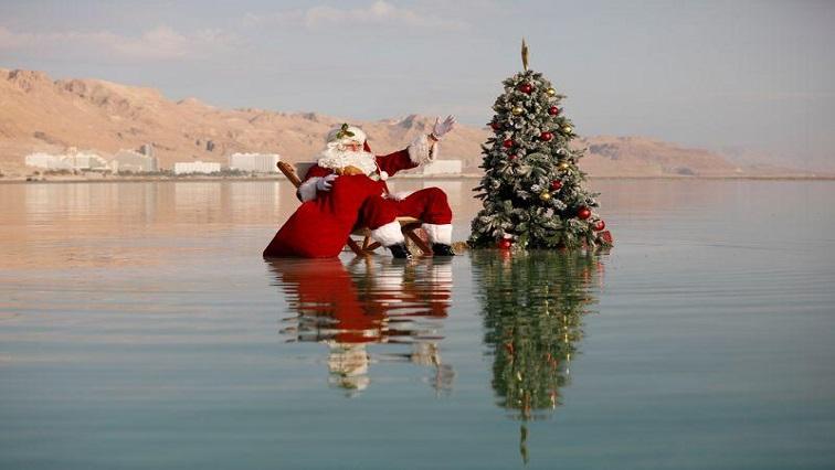 SABC News Santa R - Swimming Santa brings Dead Sea to life with tree and cheer