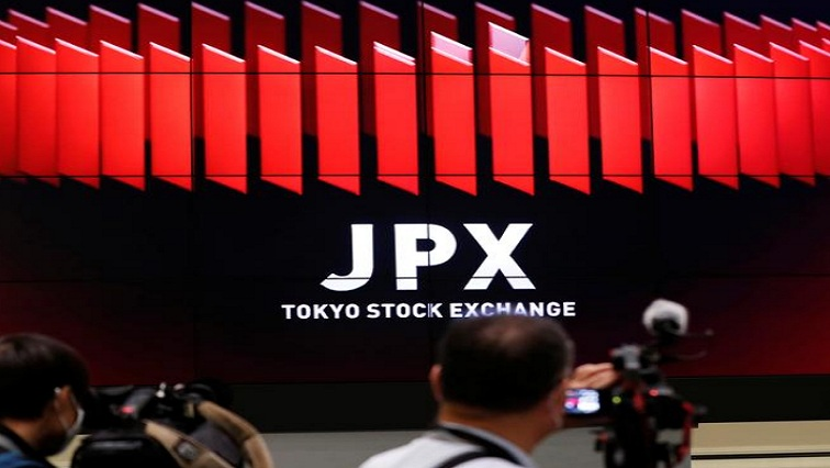 exchange 1 - Asian shares grind lower amid vaccine doubts, economic concern