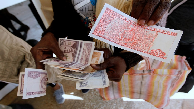 SABC News Cuban bank notes Reuters - Cuba's looming monetary reform sparks confusion, inflation fears