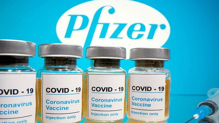 father 2 - Hailing 'turning point', Britain begins roll-out of Pfizer's COVID-19 vaccine