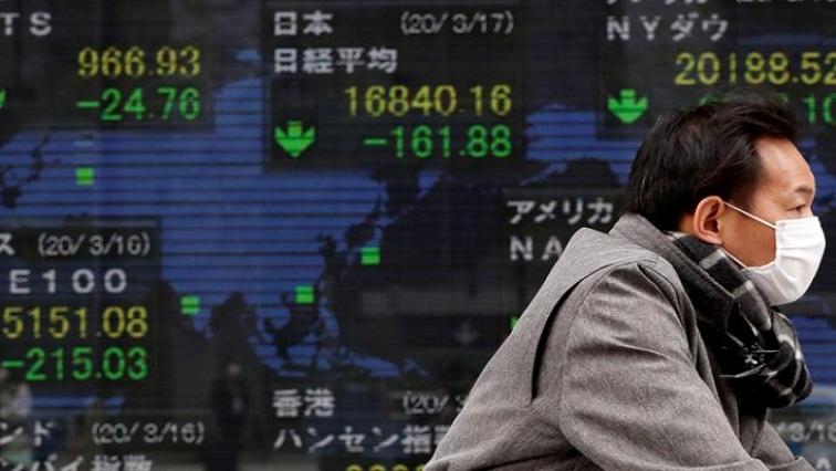 telfast 1 - Asian shares mixed, US dollar near 2-1/2 year lows