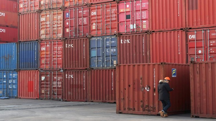 SABC News Shipping containers Reuters - Global economy can shake off pandemic in 2021, leaders say